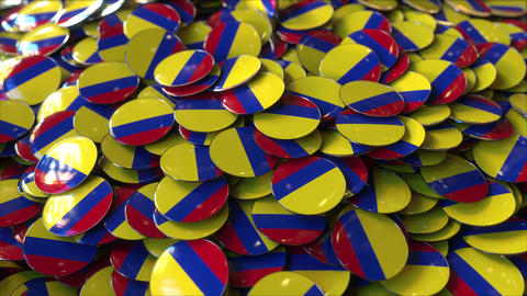 Pile of badges featuring flags of Colombia Live Action
