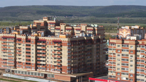 High Apartment Houses against Green Hills Sky Horizon Archivo