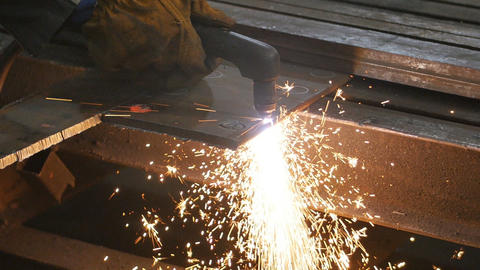 Welding works on a black background and a lot of sparks flying around, in blur Live Action