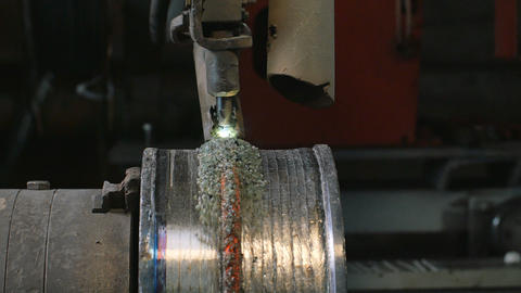 Welding robots apply overlay weld protection on the pipe disks. Automatic Footage