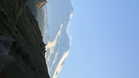 Vertical video. Mount Elbrus in the light of the setting sun. Russia Footage