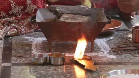 Closeup Local Woman Puts Burning Balls into Fireplace Pot Archivo