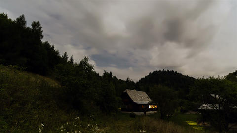 Clouds moving over cottage at night time lapse. Romantic... Stock Video Footage