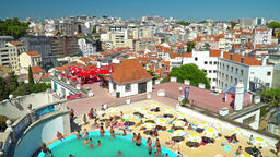 People Having Fun At Swimming Pool On Lisbon City Rooftops Footage