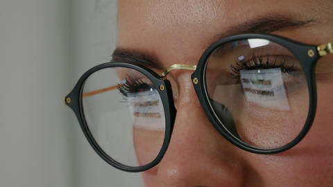 Reflection at the glasses of young woman: looking a site Footage