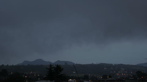 Moonrise time lapse with rapid cloud movement over a small city Footage