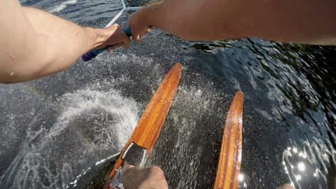 POV of a man finishing water skiing and letting go of the tow rope and going Footage