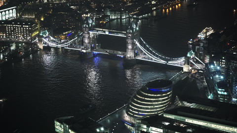 London Tower Bridge by night aerial view - LONDON, ENGLAND Live Action