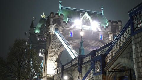 London Tower bridge in the fog by night - LONDON, ENGLAND Live Action