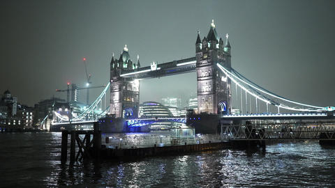London Tower Bridge wonderful illuminated by night - LONDON, ENGLAND Live Action