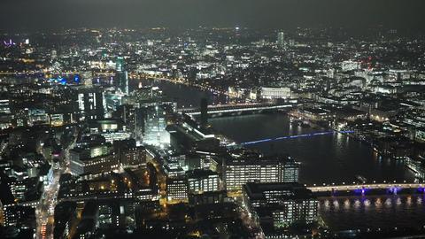 The wonderful bridges of London illuminated by night - LONDON, ENGLAND Live Action