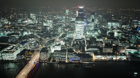 London Bridge and City of London skyscrapers by night - LONDON, ENGLAND Live Action
