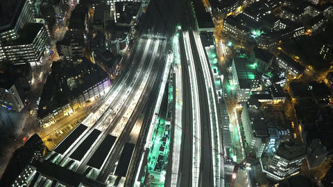 Illuminated railway tracks at London Bridge station by night amazing shot - LOND Footage