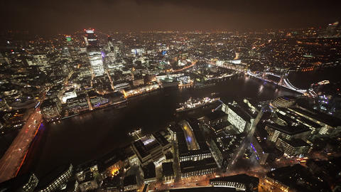 The city of London and Tower Bridge by night aerial view - LONDON, ENGLAND Live Action