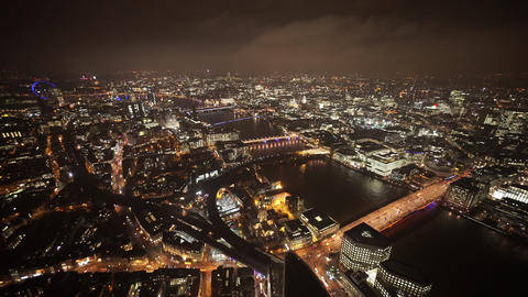 The colorful bridges of London by night wide angle shot - LONDON, ENGLAND Live Action