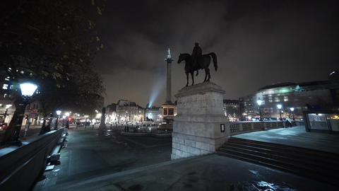 Statue and monument at Trafalgar Square London by night - LONDON, ENGLAND Live Action