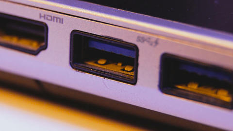 Closeup of USB flash drive inserted into port on the side of a laptop Footage