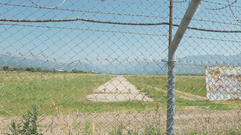 Walking along the barbed wire fence of the airport. Batumi, Geoargia Footage