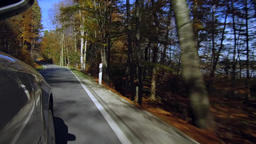 Car driving on a street in autumn Footage