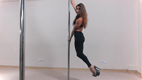 Beautiful sexy white pole dancer, woman is dancing near the pole, erotic dancing Footage