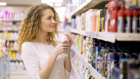 Beautiful Woman Looking at Cosmetics in Supermarket Live Action