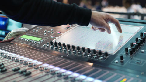 Recording studios audio console and knob. Sound director records announcer Footage