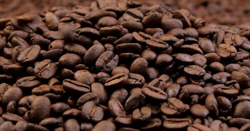 Roasted coffee beans falling on heap 영상물