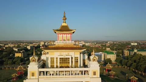 The golden abode of Buddha Shakyamuni at sunrise is the largest Buddhist temple Live Action