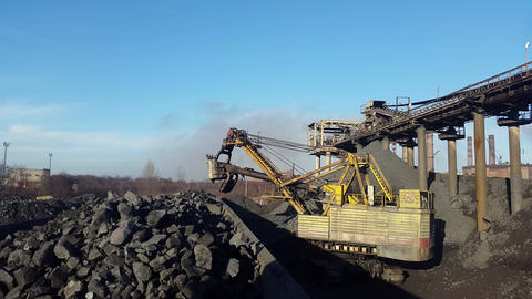 Loading the ore into heavy dump truck at the opencast mining Footage