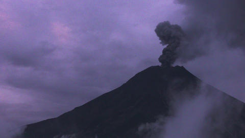 distant view of Tungurahua volcano while erupting night shot Footage