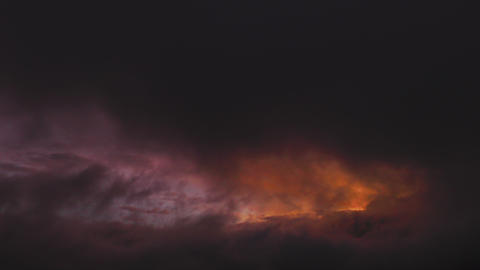 dramatic sunset viewed trough thick clouds at thigh altitude in Andes mountains  Footage