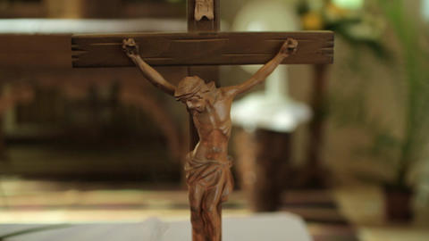 Little Crossed Jesus Figure On A Table