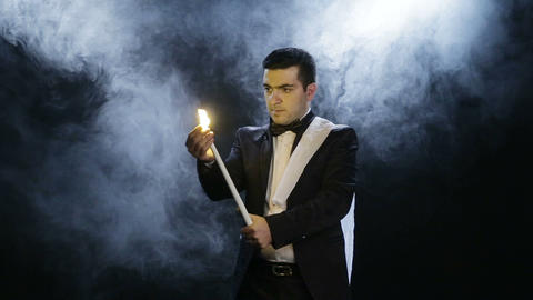 The Magician Shows Tricks With A Candle, Which Disappears Footage