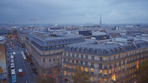 The city of Paris with Eiffel tower in the evening aerial view from a roof top Footage
