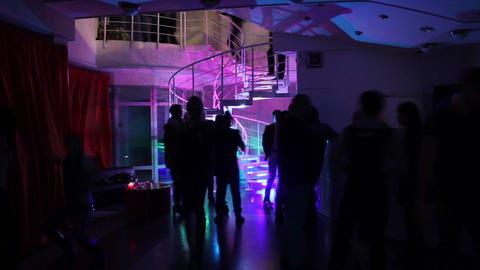 Time-lapse of people filling the night club, going up the stairs Footage