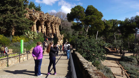 Walkway terrace at Park Guell, pan shot, sunny day, Planter's viaduct ahead Footage