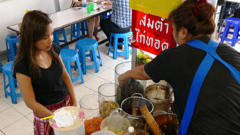 Ordering som tam, Isan food at Lalai Sap Market Footage