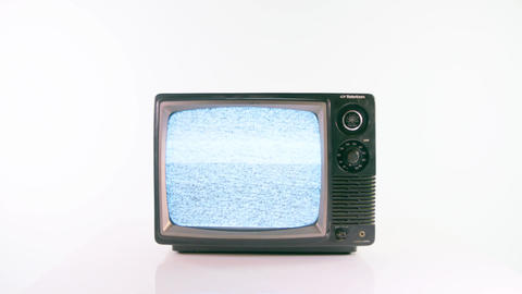 Zoom in on vintage TV playing static on white background Live Action