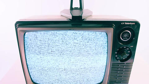 Blue tinted vintage TV playing static Footage