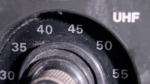 Close up of old fashioned dials on a vintage TV Live Action