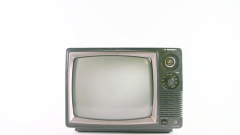Pan down on old fashioned TV on white background Live Action