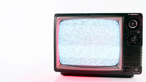 Pan of vintage television with red light on white background Footage