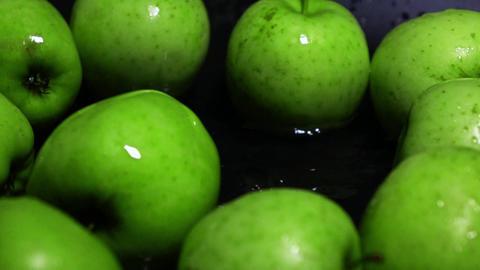 Green apple falling in water Footage