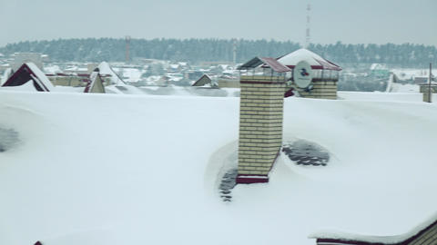 Snowy sloped roofs of dwelling houses in winter Footage