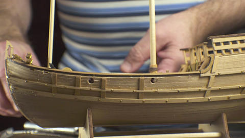 Model of a wooden ship on a wooden table, side view. Video Footage