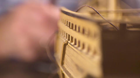 Model of a wooden ship on a wooden table, blur. Video Footage