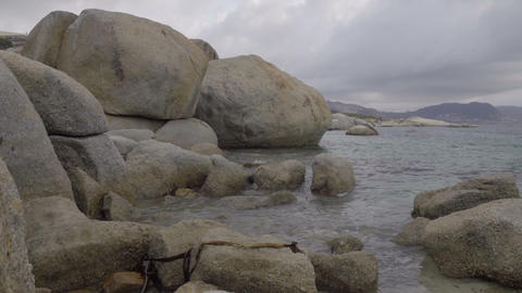 Granite boulders on the shore near Boulders Beach Footage
