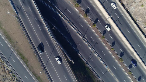 Aerial view of cityscape curve roads with cars Footage
