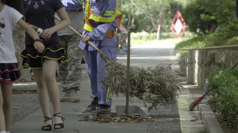 City street cleaner sweeps with a branch broom Footage