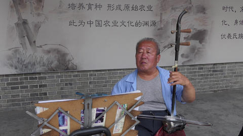 Old Chinese Man Playing Traditional Musical Instrument Music In China Live Action